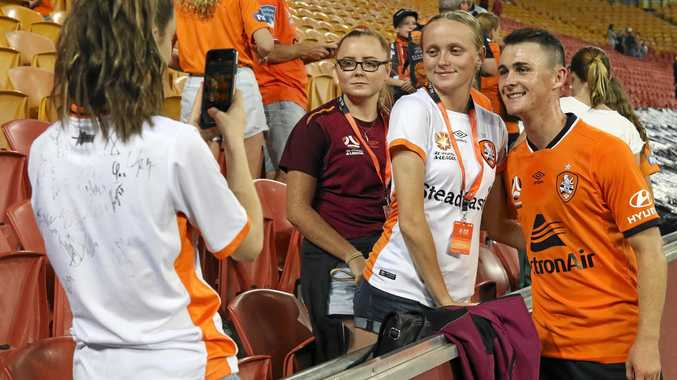 Ipswich footballer Dylan Wenzel-Halls mingles with fans after coming on as a late substitute in Brisbane Roar's 2-0 A-League victory over Melbourne City at Suncorp Stadium on Saturday night.