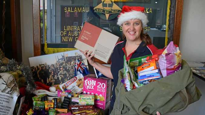 Maroochy RSL volunteers are putting together Christmas care packs for the troops, similar to these shown by Tam Geritz at Maryborough RSL.