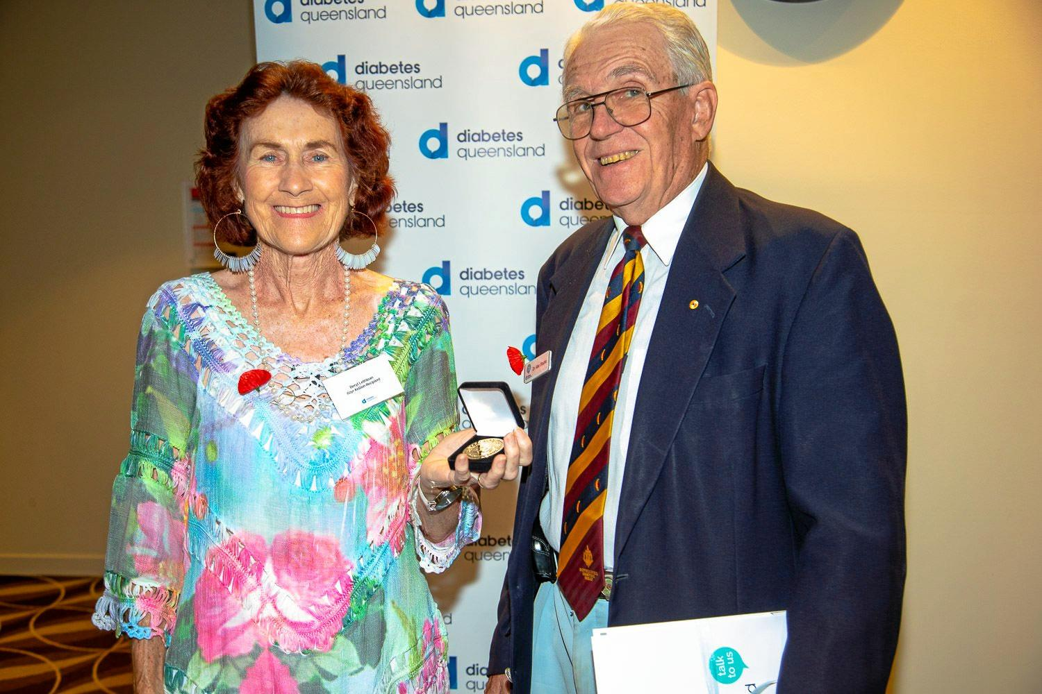Point Vernon woman Beryl Lethlean received her 60 year medallion from Dr Alan Stocks AM of the Kellion Diabetes Foundation.