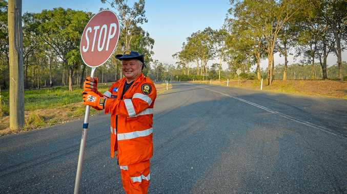 NO-GO ZONE: Doug from Baffle SES controls a closed road at the corner of Fernfield and Coast Roads.