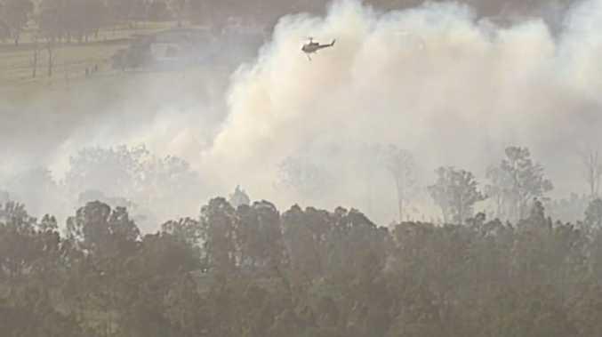 A bushfire burning in Beaudesert yesterday.
