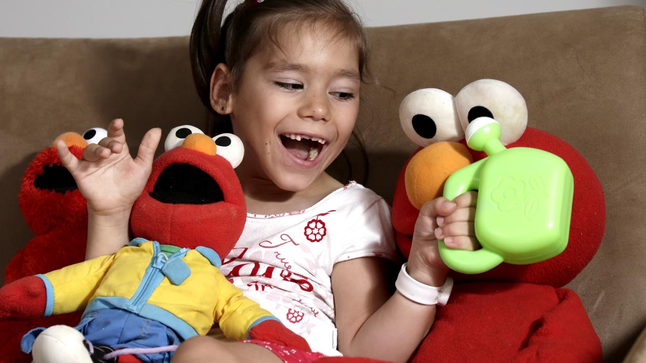 Emma Deede who has Cerebral Palsy, plays with the toys on the lounge PICTURE: ANNA ROGERS