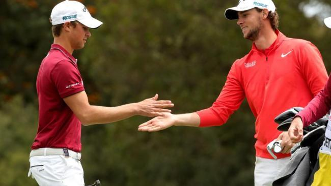Thomas Detry and Thomas Pieters celebrate a birdie during the final round.