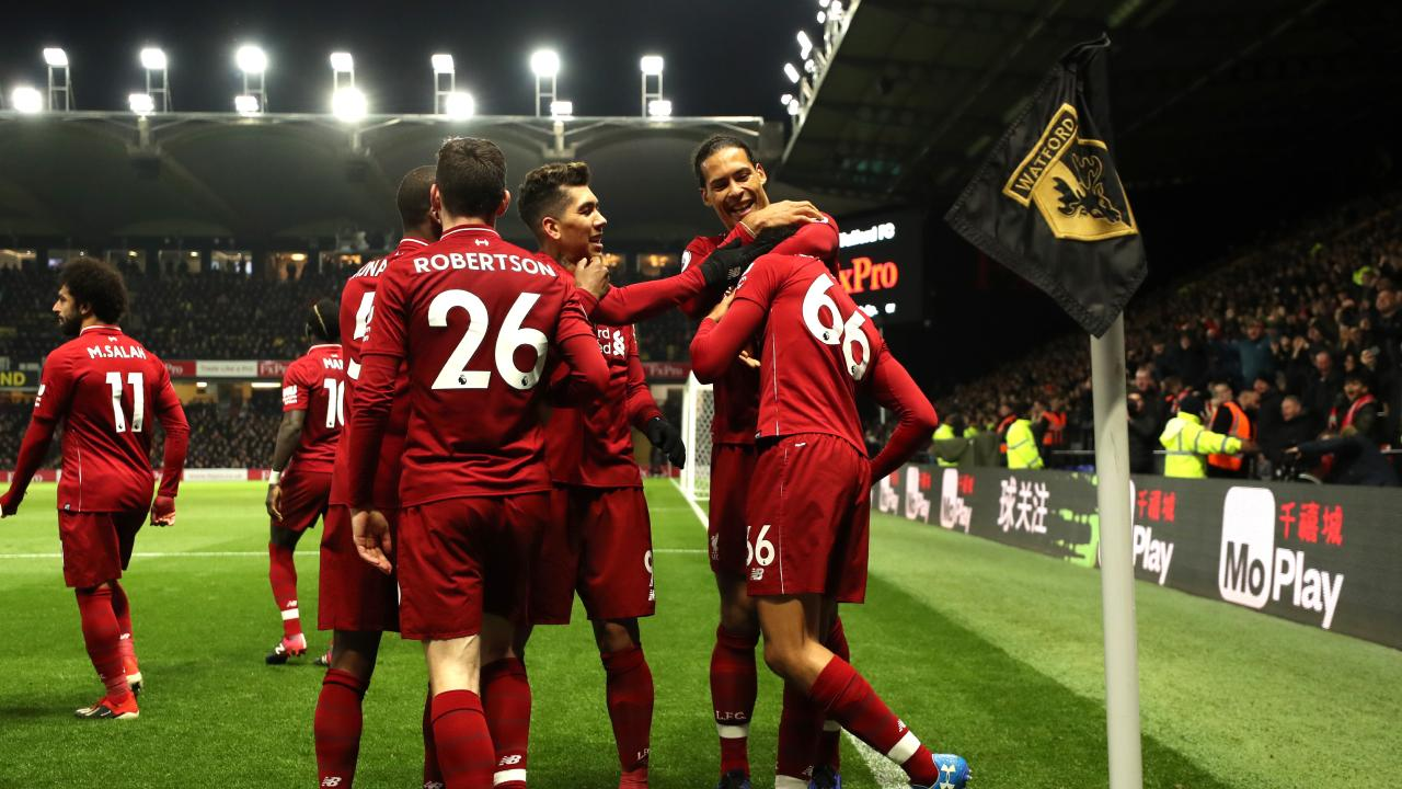 Trent Alexander-Arnold of Liverpool celebrates with teammates after scoring his team's second goal