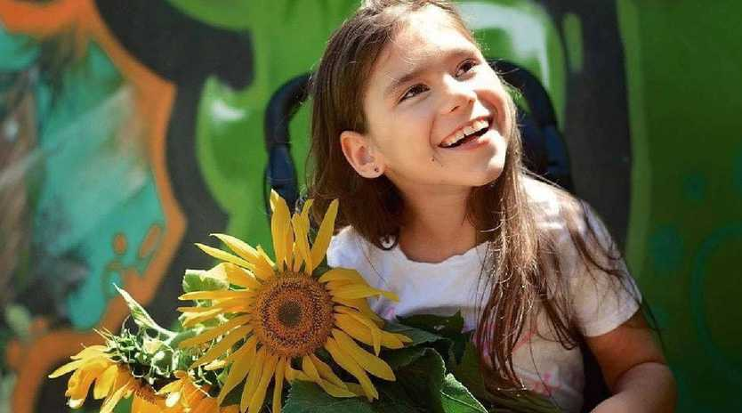 Cairns girl Emma Deede will this month undergo a potentially life changing stem cell treatment in Bangkok. The eight-year-old is wheelchair-bound and unable to speak, sit or stand independently.