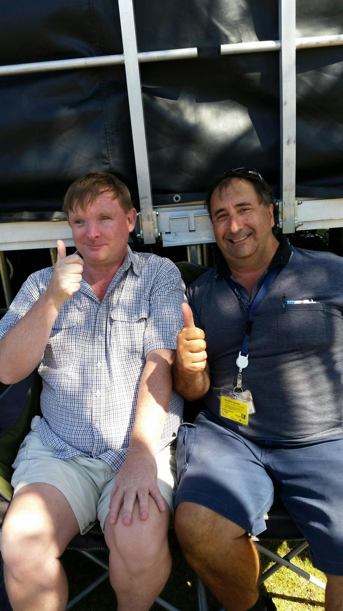 Brian and his support worker David give the thumbs up to the NDIS.