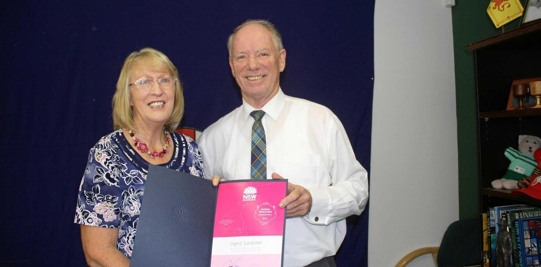 RECOGNISED: Ingrid Gardiner accepts her award from State Member for Coffs Harbour Andrew Fraser.
