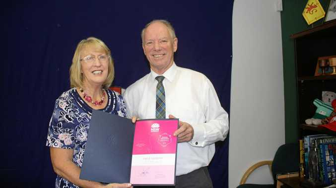 RECOGNISED: Ingrid Gardiner accepts her award from State Member for Coffs Harbour Andrew Fraser.