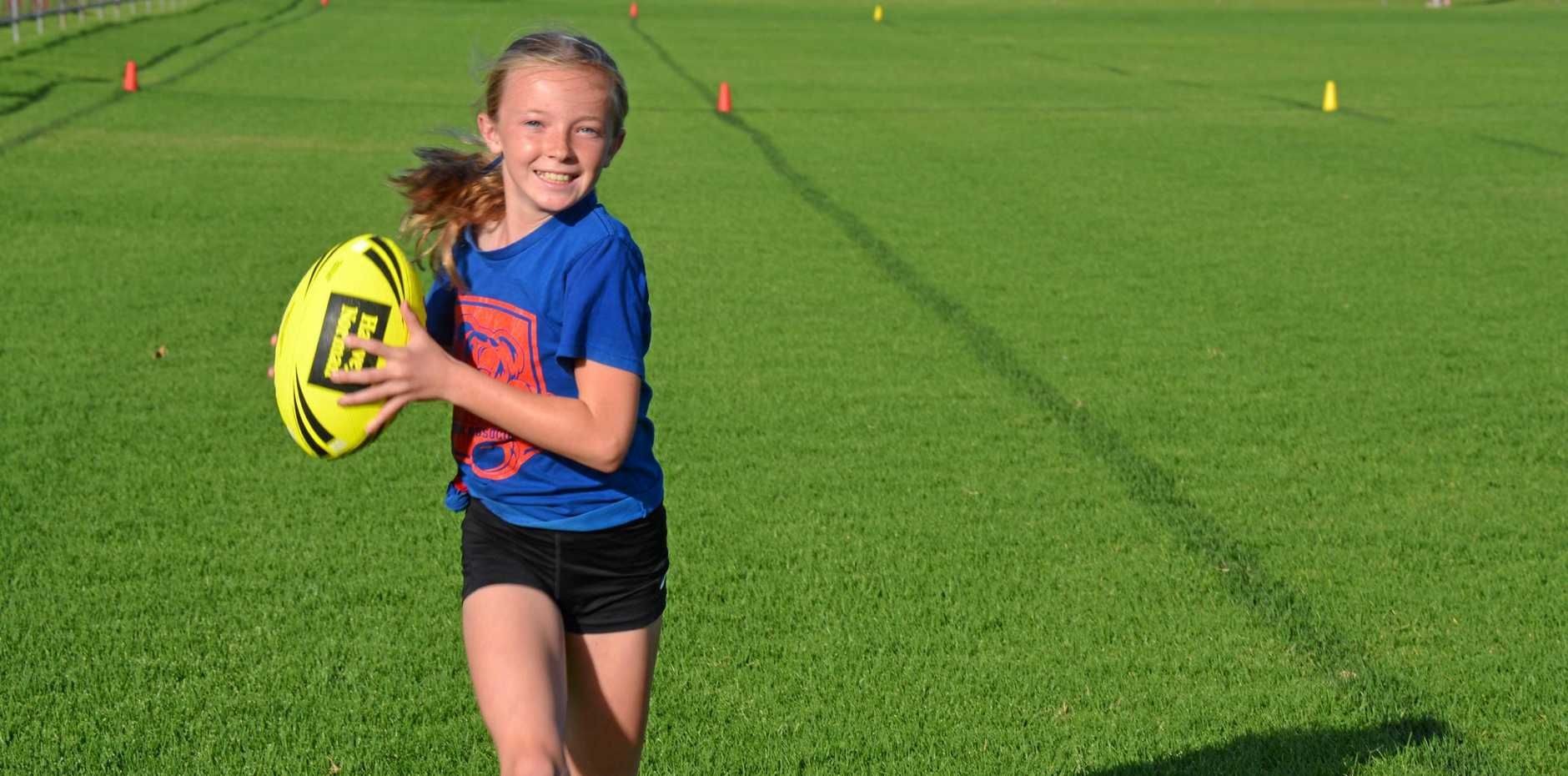 RUNNING AHEAD: Sharne Whyte loves to play touch football.