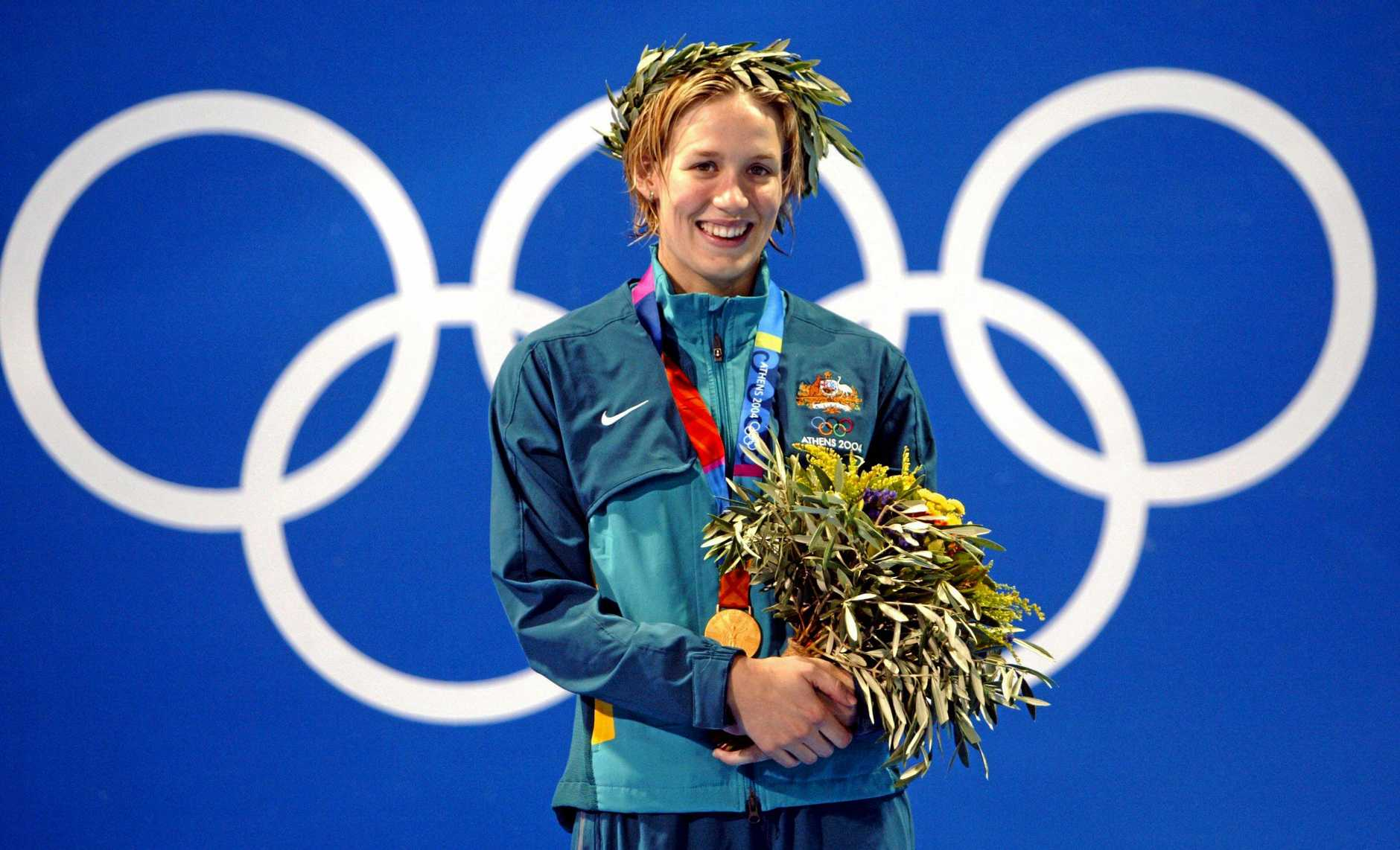 Jodie Henry with her gold medal following the 100m freestyle at the Athens 2004 Olympic Games.