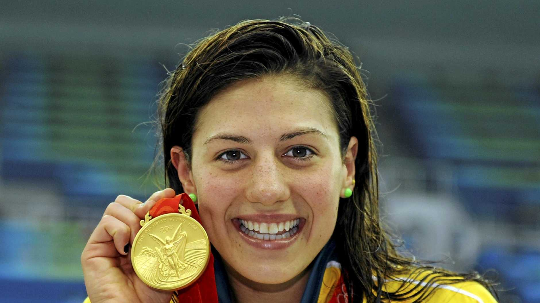 Stephanie Rice with her gold medal after winning the 200m IM at the 2008 Beijing Olympic Games.