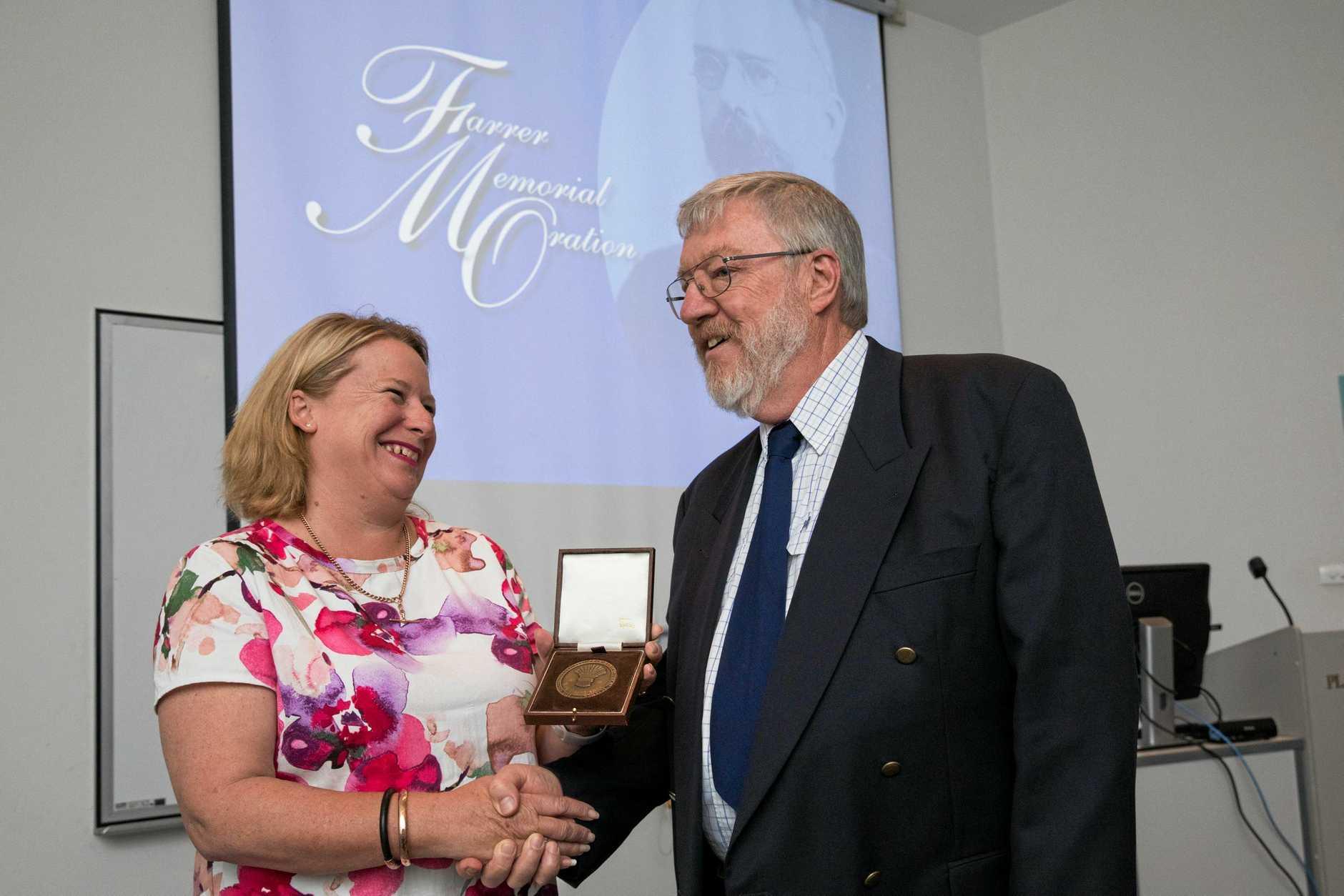 HUGE SUCCESS: 2018 Farrer Memorial Medal winner Dr Reg Lance and DPI Deputy Director General Kate Lorimer-Ward.