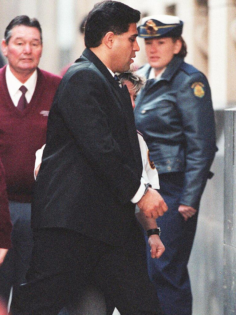 Tony Kellisar is escorted into during his murder trial. Picture: Simon Dallinger