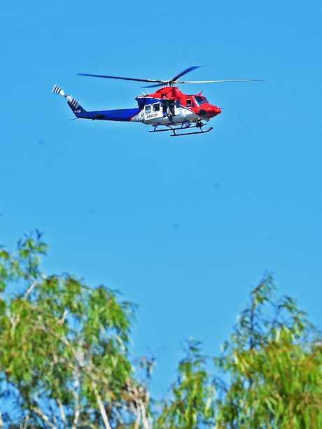 Rescue helicopter searches the Black River. Picture: Zak Simmonds