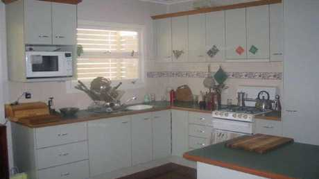 BEFORE: The kitchen was tidy, but dated.