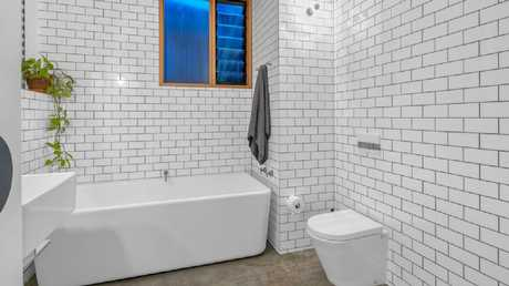 One of two new bathrooms in the home at 17 Hove St, Highgate Hill, after the renovation.