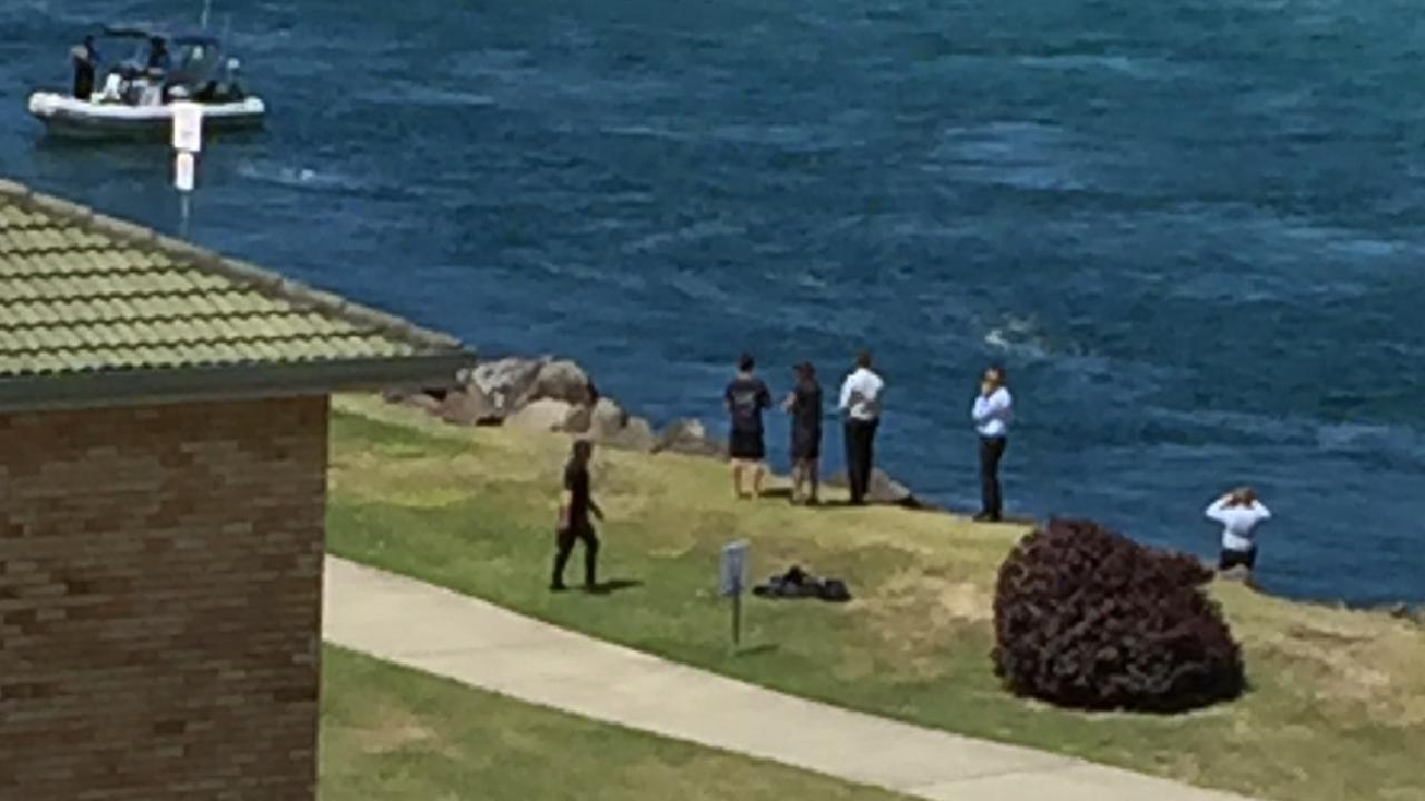 Locals told the Courier Mail they saw police throwing objects into the water. Picture: Greg Stolz