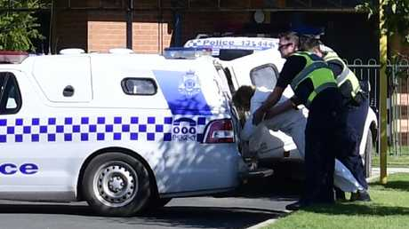 The woman accused of drowning her five-year-old son in the Murray River is taken back into the police van after appearing in court via videolink from Echuca Regional Health in 2017. Picture: Ivy Wise/ Riverine Herald.