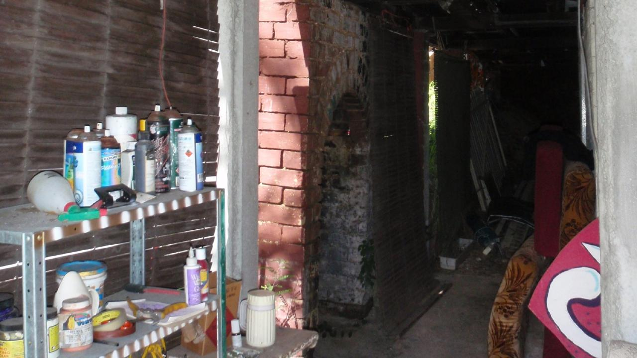 Underneath the house at 17 Hove St, Highgate Hill, before the renovation.