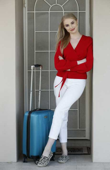 Kassandra Kashian, 23, finds it difficult to pack light when travelling interstate with carry-on. Picture: David Swift