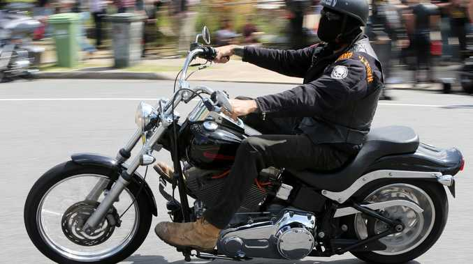 A Hells Angels bikie who allegedly tried to set fire to a former gang member's fence was only trying to retrieve his motorbike, a court has heard.