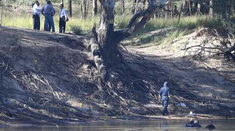Victorian police divers search the Murray River for a missing boy on Friday, March 3, 2017, in Moama, New South Wales, Australia. Picture: Hamish Blair