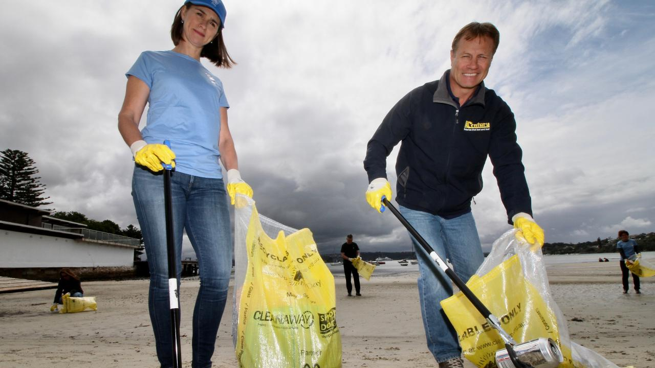 Century brand ambassador and TV fishing show host Andrew Ettingshausen with Clean Up Australia director Pip Kiernan doing their bit to promote keeping our beaches and waterways clean.