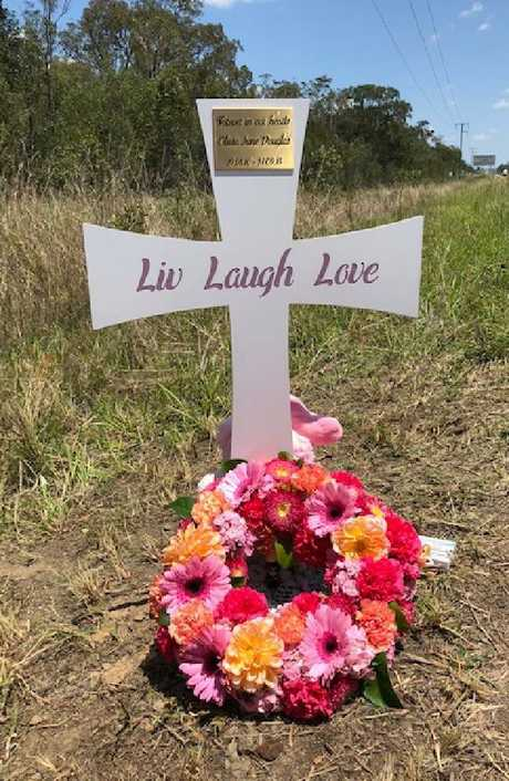 The cross on the side of the Bruce Highway, near Childers, where Olivia died.