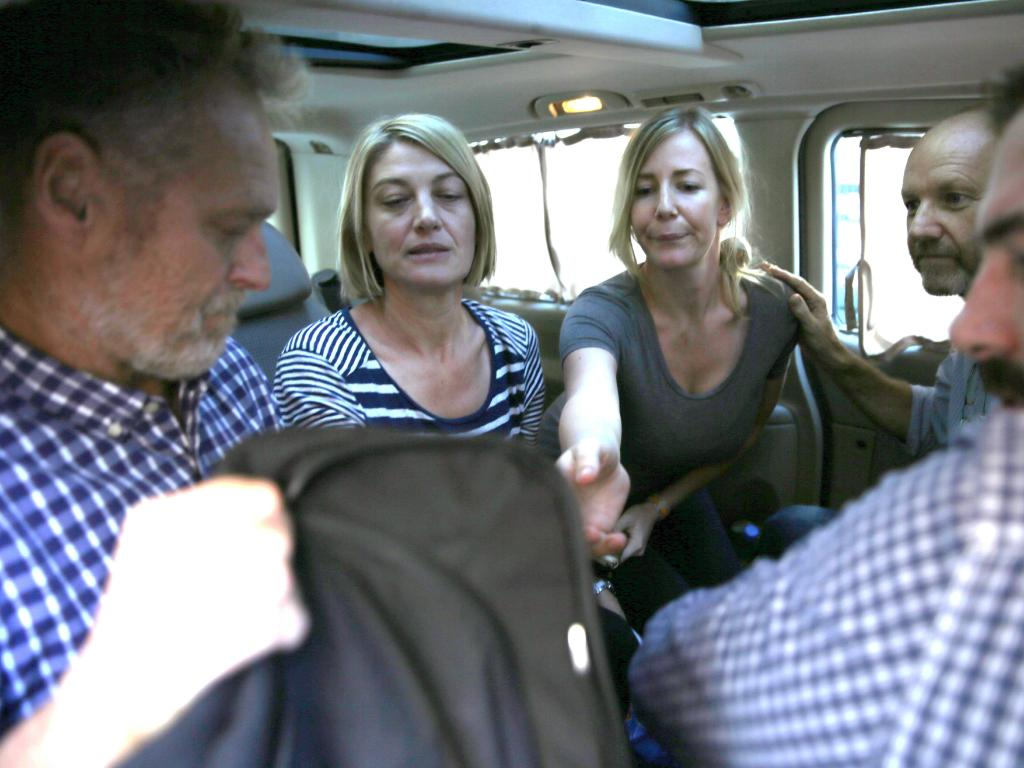Tara Brown, second left, with Sally Faulkner, centre, and three crew members from 60 Minutes. Picture: Hussein Malla/AP