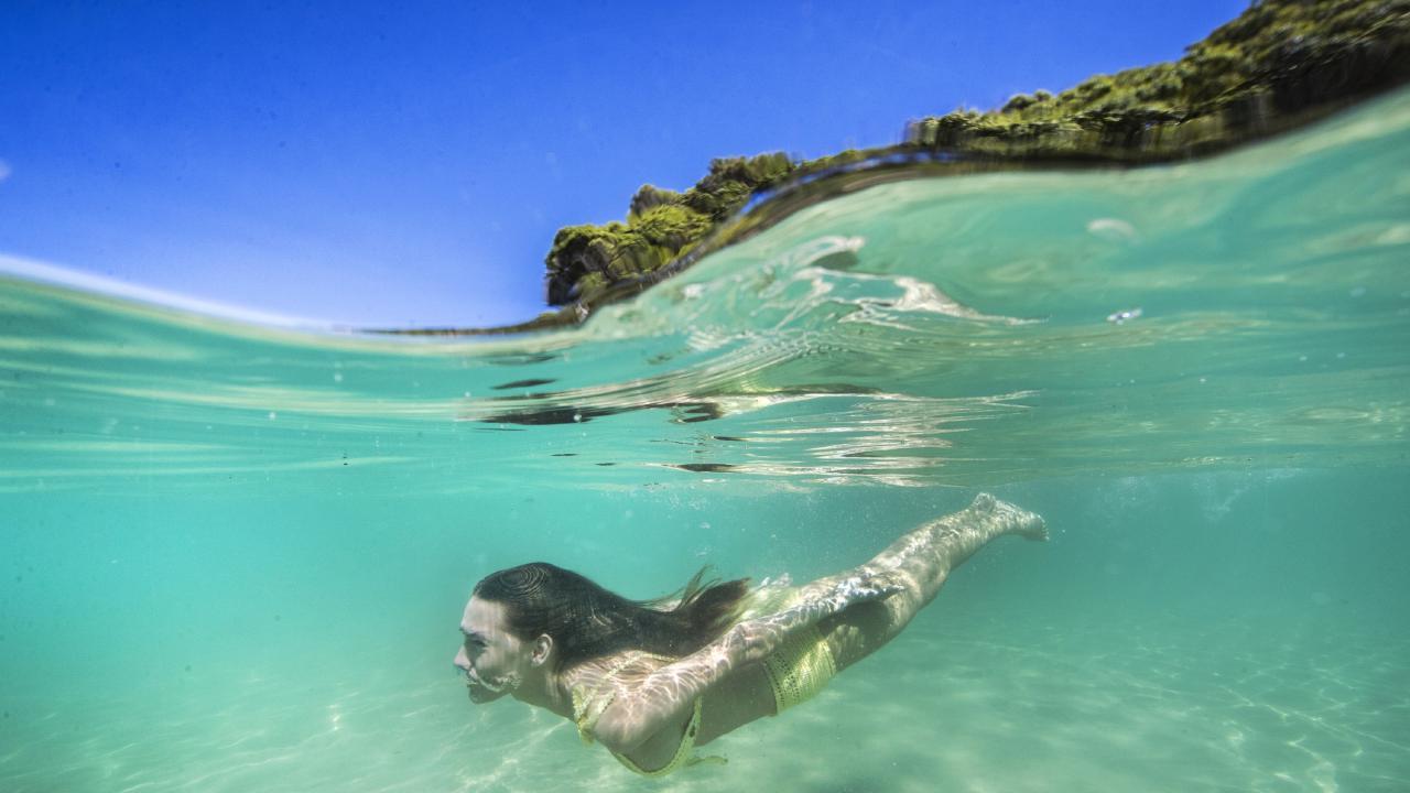 Ashleigh Allerton takes a dip at Tallebudgera Creek. Picture: Nigel Hallett
