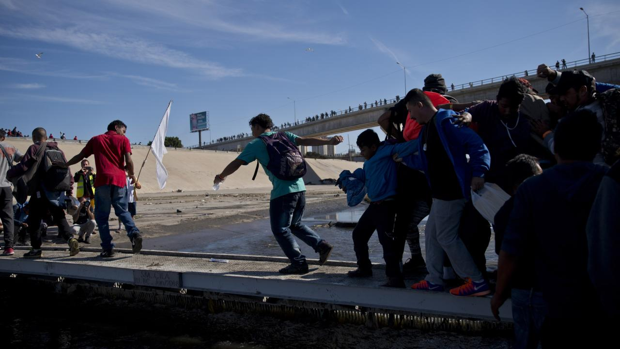 Migrants were tear-gassed by US agents as the border crossing was closed. Picture: AP Photo/Ramon Espinosa