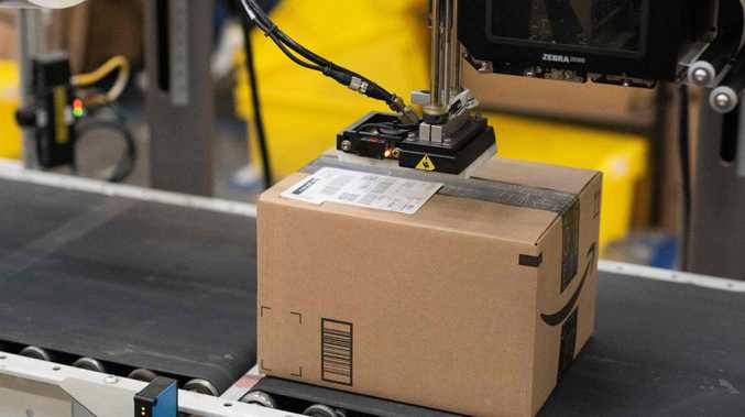 A package leaves the Amazon shipping centre.