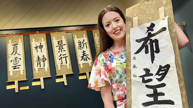 WRITING HER FUTURE: Anna Parker with Japanese calligraphy.