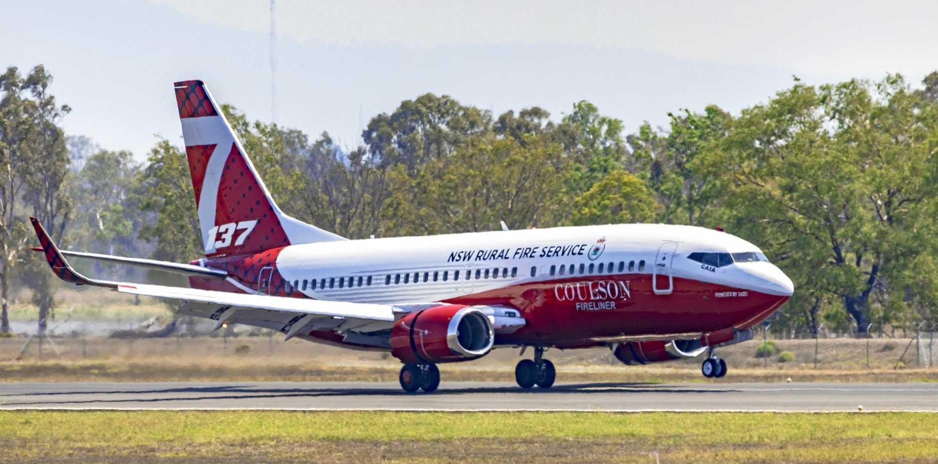 NSW Rural Fire Service Boeing 737-3H4 Water Bomber landing at Rockhampton Airport