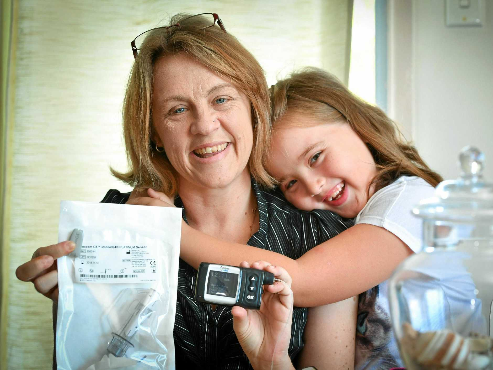 BOOST: Type 1 diabetic Jaceen Ross with her daughter Alannah Ross-Hong, 8. The Federal Government has announced $100 million in funding to support type 1 diabetes patients.