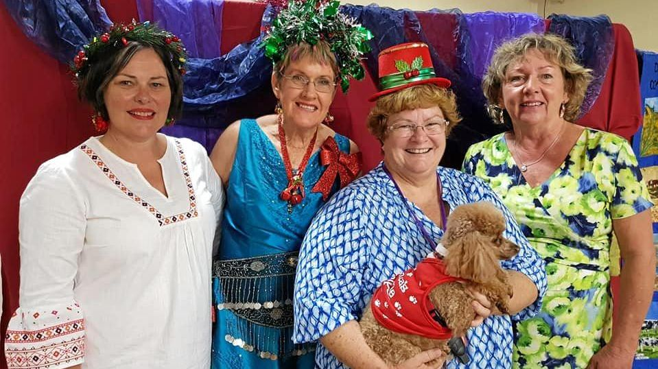 Melissa Barnett, Marg Enkelmann, Sister Christine with Lady Kenya, and Lesley Thun at the Christmas with a Cause function.