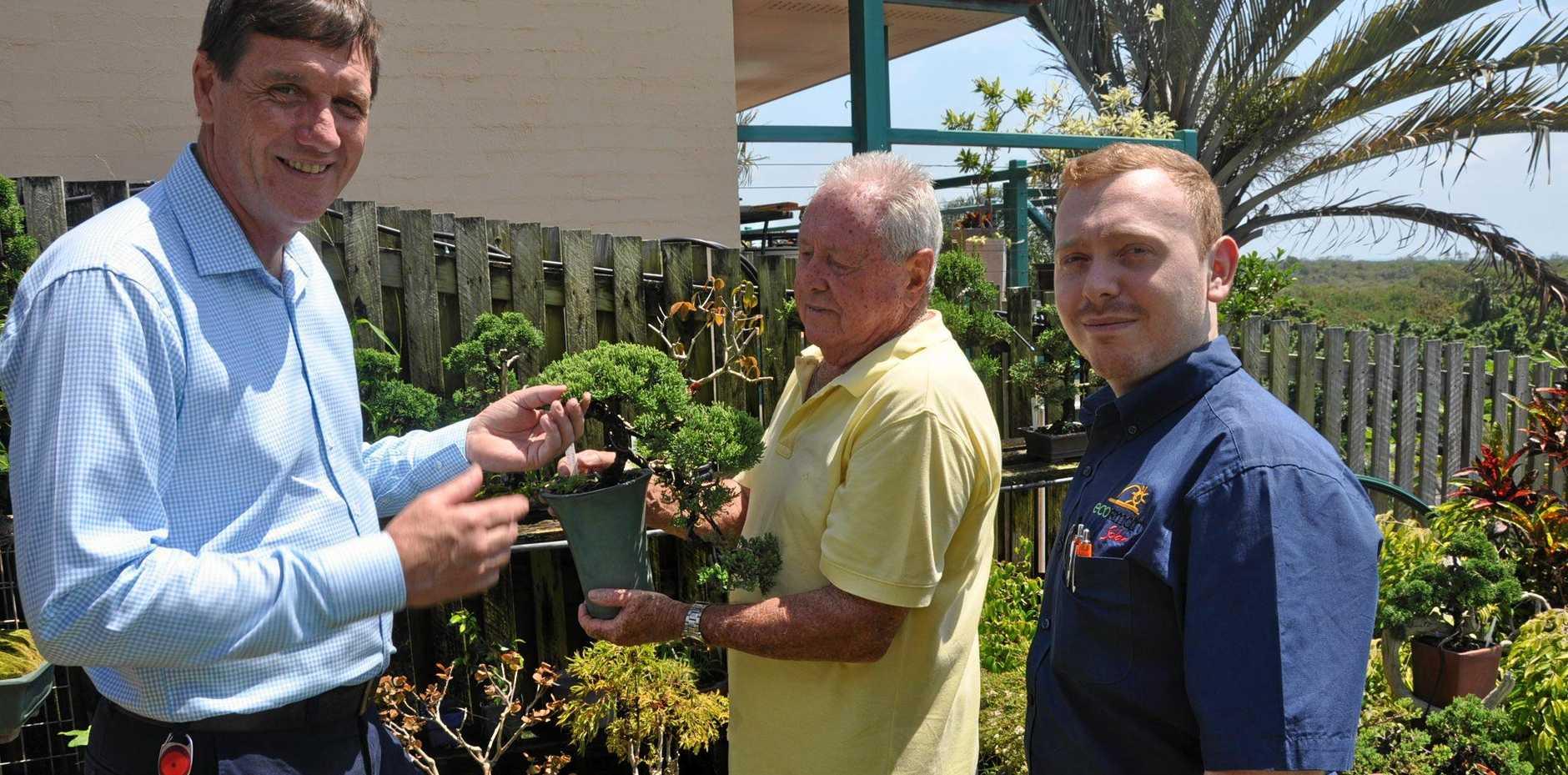 SOLAR PLANT: Anthony Lynham with Coast resident Hugh Chardon and Eco Smart Solar's Matthew Minter. Dr Lynam says like a bonsai, you can shrink your power bill.