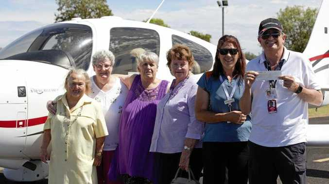 SPREADING THE LOVE: Members of Actively Ageing Balonne Eadie Perkins, Colleen Faulkner, Ann Lee, Cherry McKee, Samantha Darcy donated a cheque to Angel Flight pilot/volunteer Andrew Offen