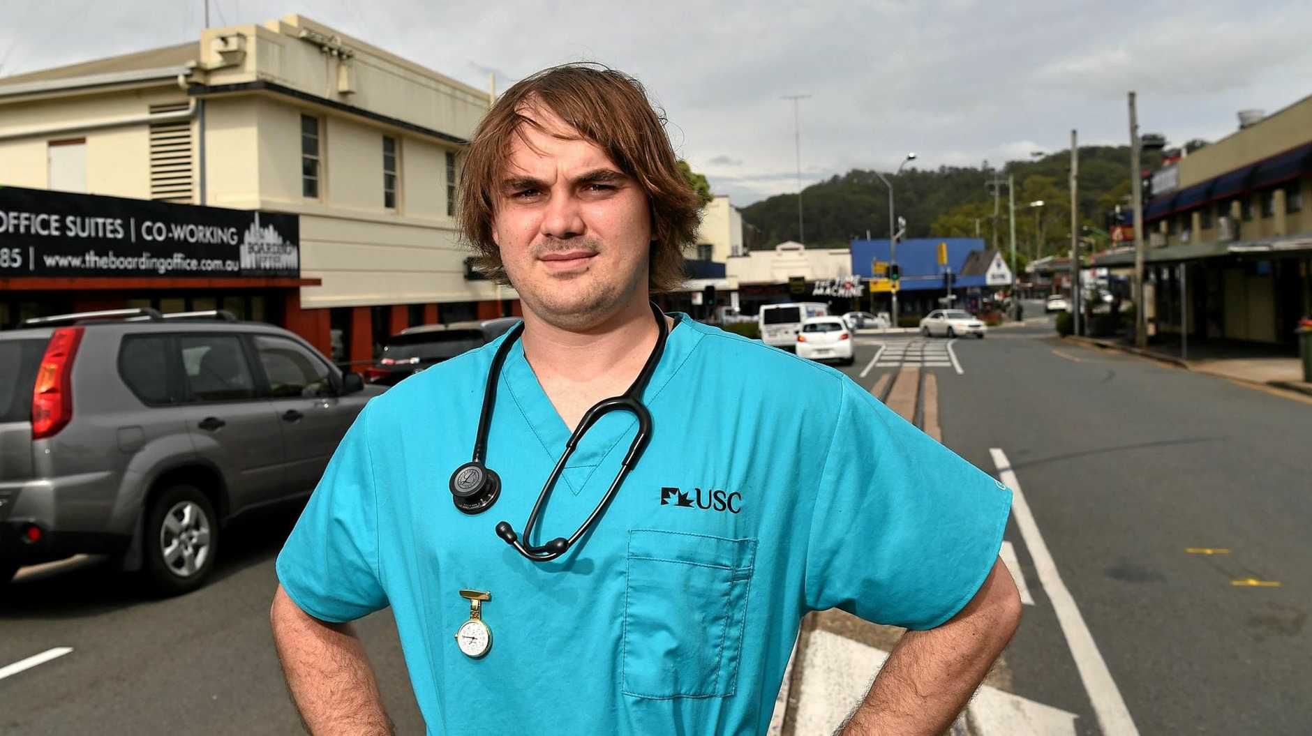 CPR SUPERSTAR: University of the Sunshine Coast student nurse Aaron Collins helped resuscitate an elderly man who was crossing Mill St when his prosthetic leg became caught in the cane train track causing him to fall and hit his head.