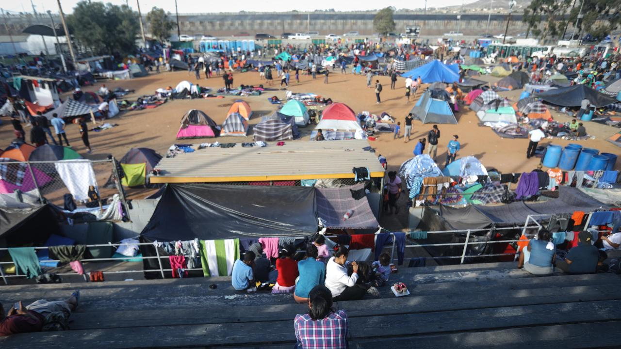 Migrants gather at a temporary shelter for members of the 'migrant caravan', located within sight of the US-Mexico border barrier on November 21, 2018 in Tijuana, Mexico. Picture: Mario Tama/Getty Images