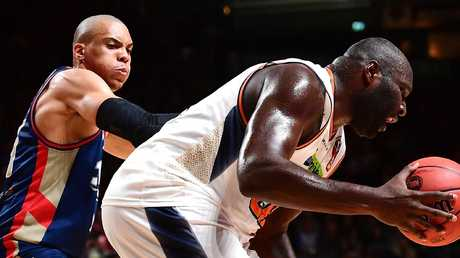 ADELAIDE, AUSTRALIA — NOVEMBER 23: Nate Jawai of the Taipans under pressure from Jacob Wiley of the Adelaide 36ers during the round seven NBL match between the Adelaide 36ers and the Cairns Taipans at Titanium Security Arena on November 23, 2018 in Adelaide, Australia. (Photo by Mark Brake/Getty Images)