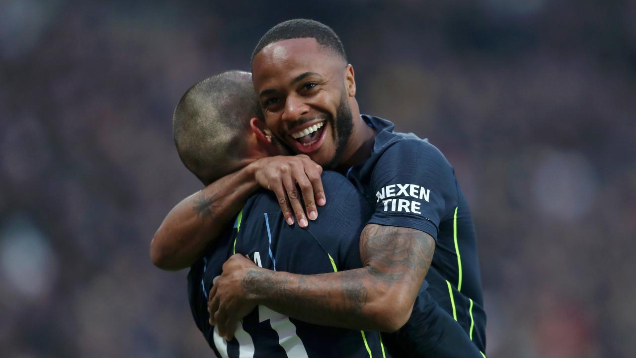 David Silva celebrates after scoring with Raheem Sterling