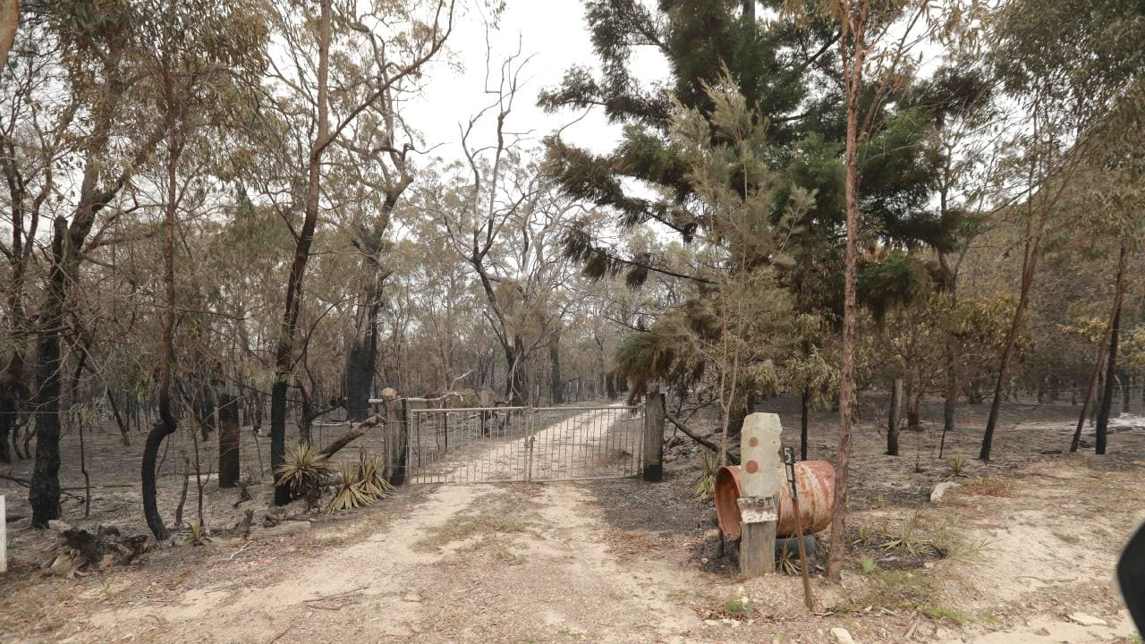 The charred entrance to a property at Deepwater. Picture: Mark Cranitch