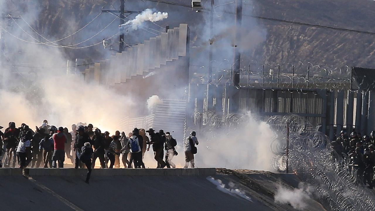 Border police used tear gas on people at El Chaparral border crossing. Picture: EPA/David Guzmán