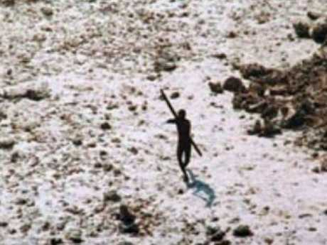 After the 2004 tsunami this member of the Sentinelese tribe was photographed firing arrows at a helicopter. Picture: Indian Coastguard/ Survival International