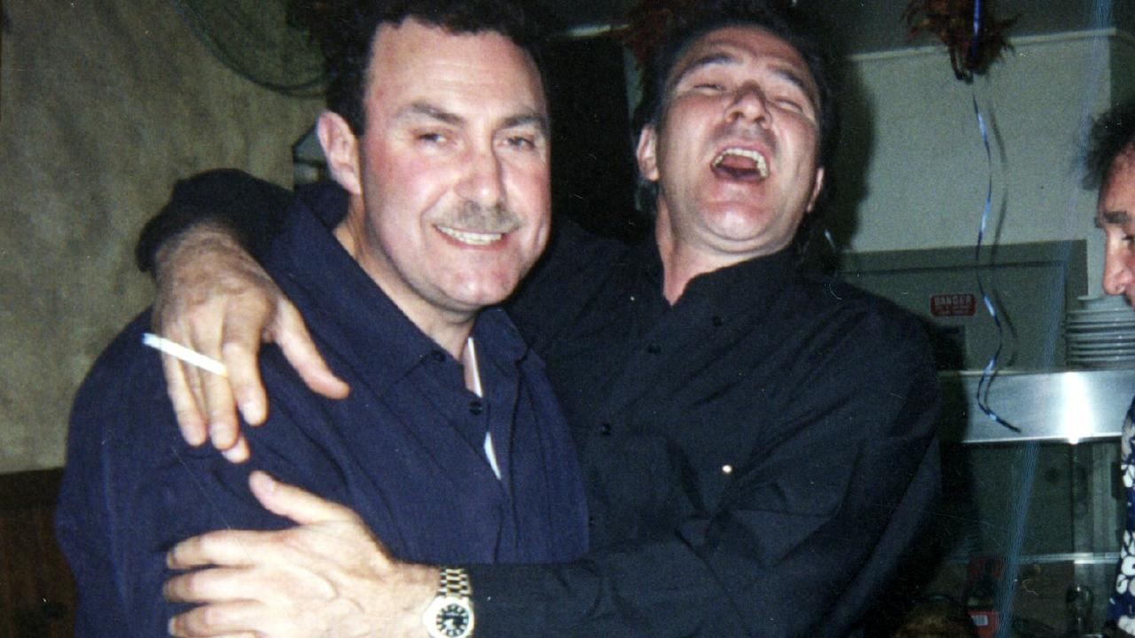 Mario Condello being embraced by Nik Radev. Picture: Supplied