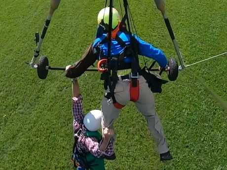 It was a rough landing, but Chris said he'd try hang gliding again. Picture: Youtube/Gursk3