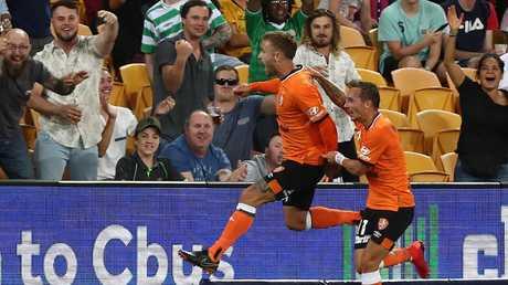 Adam Taggart of Roar celebrates a goal