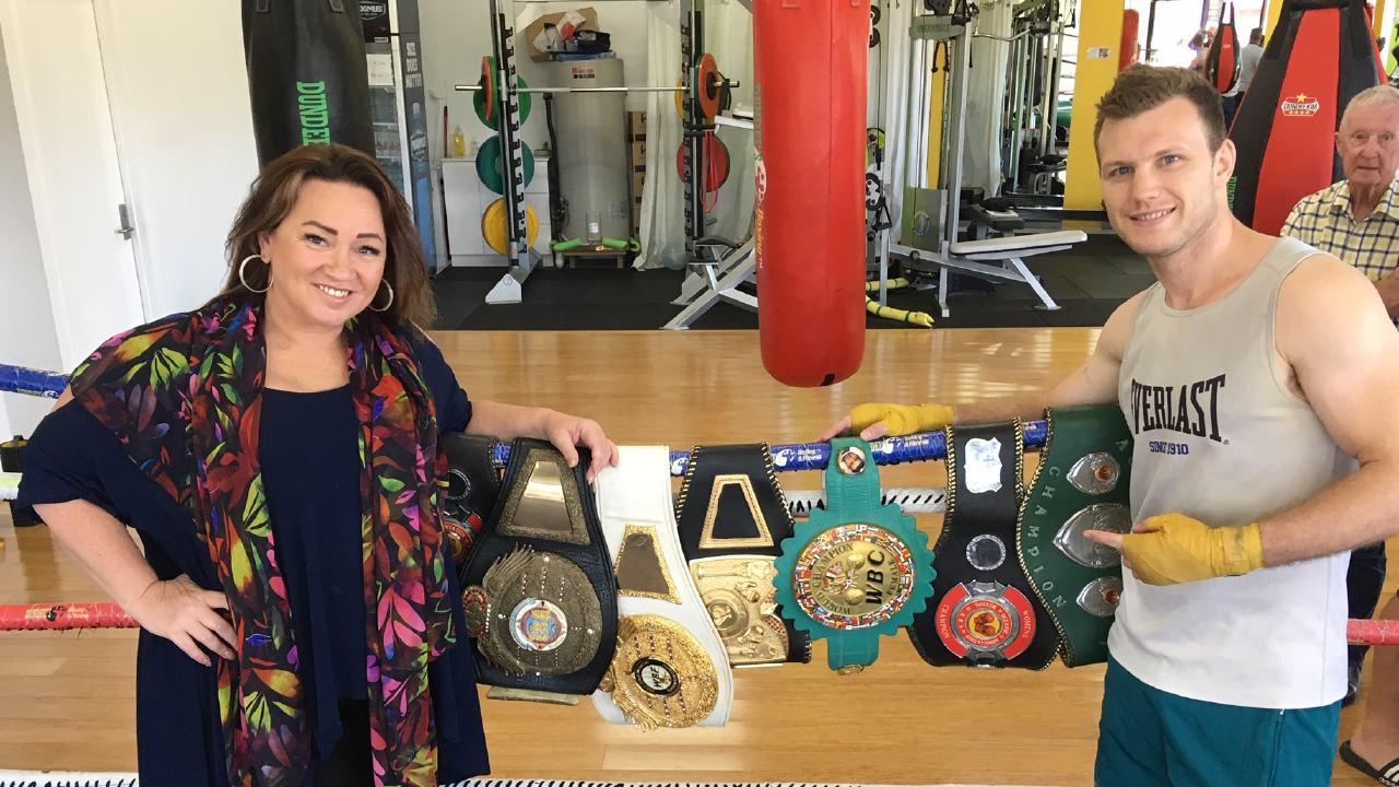Sharon Anyos with some of the belts she won.