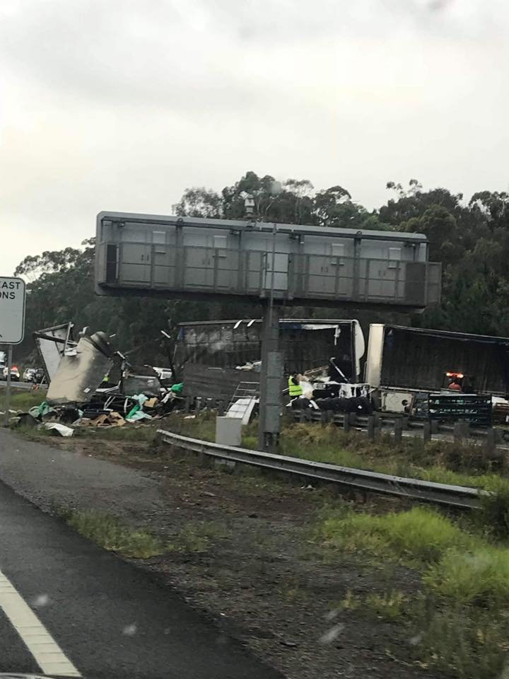 The wreckage of a B-double and car crash heading north-bound on the Bruce Hwy, near the Caloundra exit in Landsborough.